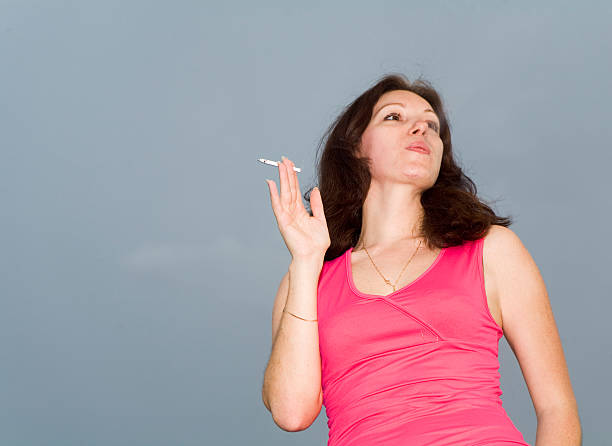 smoking woman smoking woman in scarlet clothes deleterious stock pictures, royalty-free photos & images