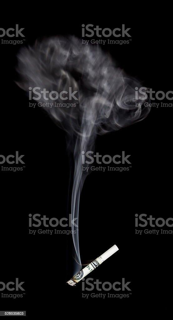 Smoking your money away stock photo