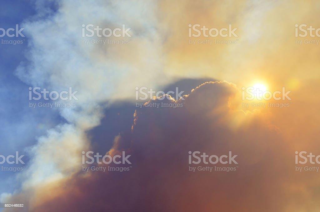 Smoky apocalyptic sun and sky stock photo