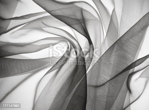 Gauze fabric backlit creates a sensual, smokey feel