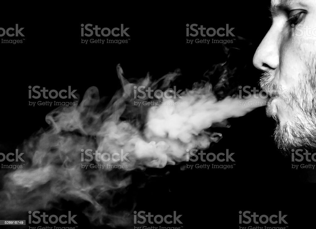Smoky man stock photo