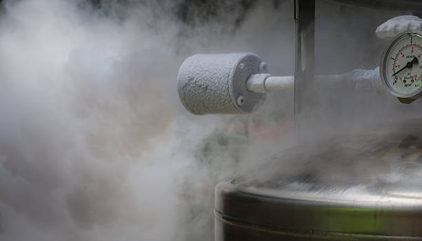 Smoky nitrogen gas discharge Excess smoky nitrogen gas discharge during filling of a liquid nitrogen dewar. cryotherapy stock pictures, royalty-free photos & images