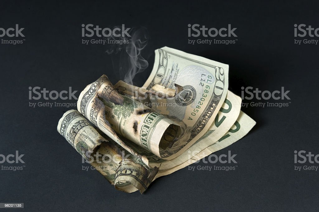 Smoldering currency royalty-free stock photo