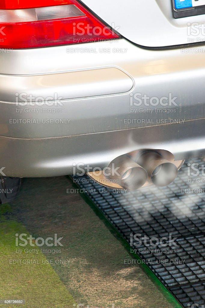 Smoldering exhaust of a Mercedes Benz Diesel stock photo