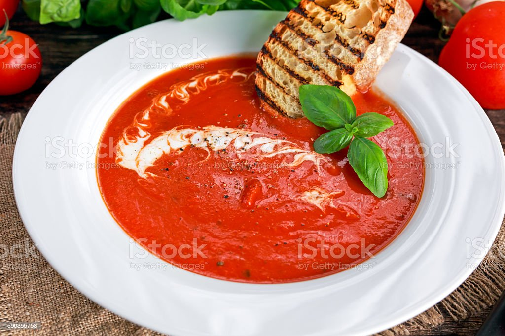 Smooth and sweet tomato soup, seasoned with basil, garlic royalty-free stock photo