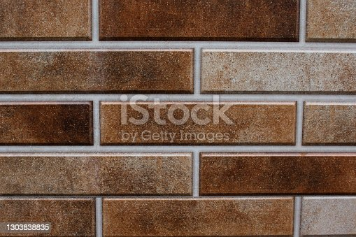 Smooth brick wall in brown colors. Horizontal image