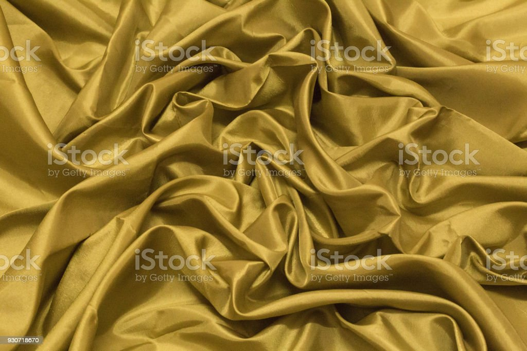 Smooth elegant gold silk or satin luxury cloth texture can use as wedding background. Luxurious Christmas background or New Year background design.Golden Canvas for Background. stock photo