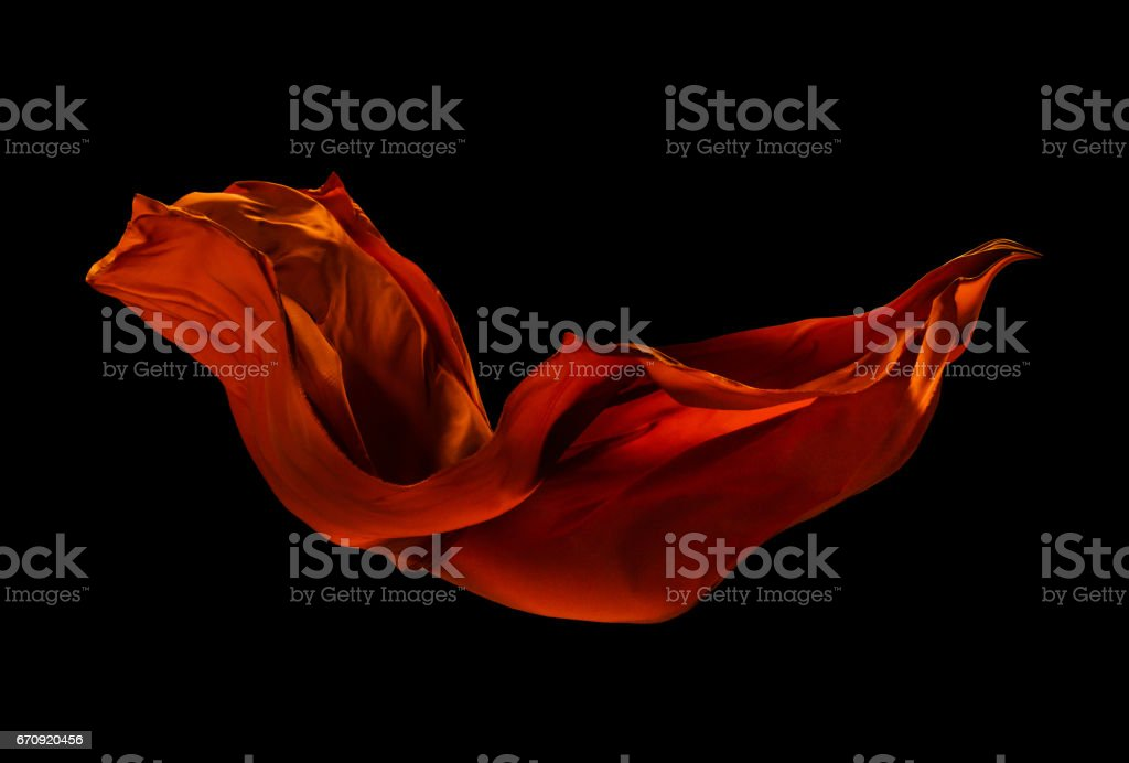 Smooth elegant red cloth on black background stock photo