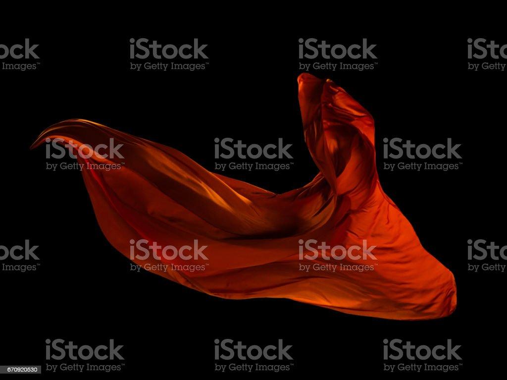 Smooth elegant red cloth on black background stock photo