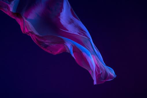 Smooth elegant transparent blue cloth separated on blue background