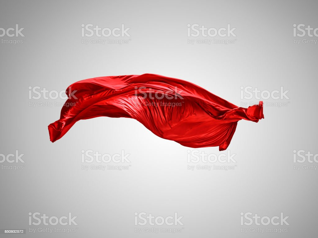 Smooth elegant transparent red cloth separated on gray background stock photo