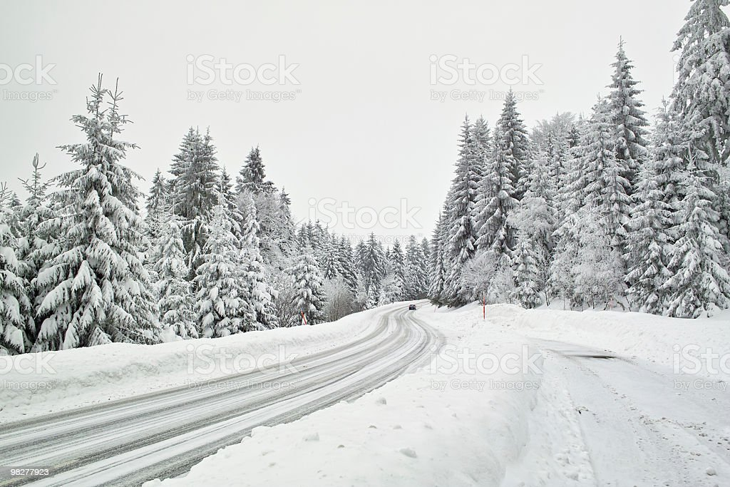 smooth icy snow covered and street in winter time royalty-free stock photo