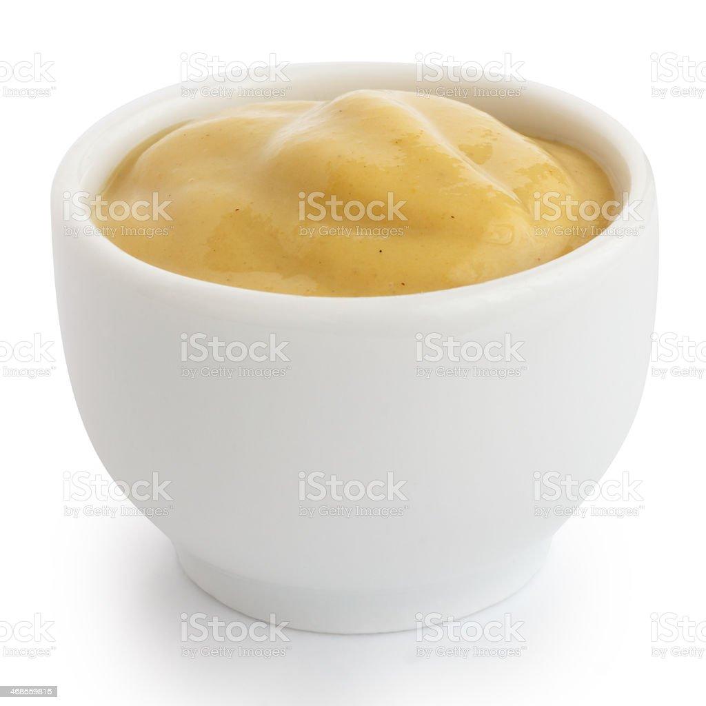 Smooth mustard in white ceramic ramekin. stock photo