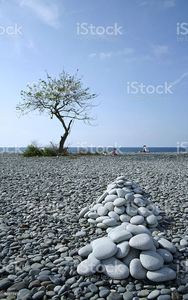 smooth pebbles stacked on beach royalty-free stock photo