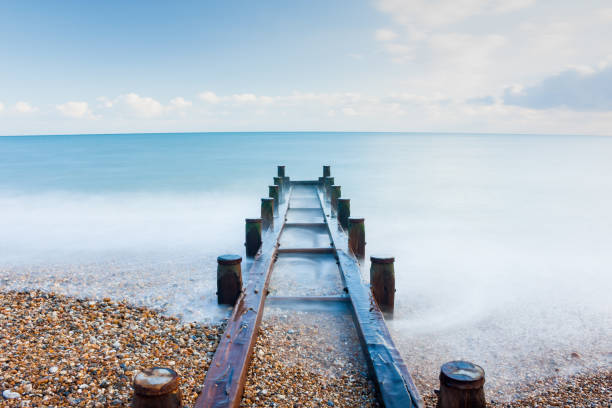 Smooth sea over a surface water outlet pipe in Bognor Regis – zdjęcie