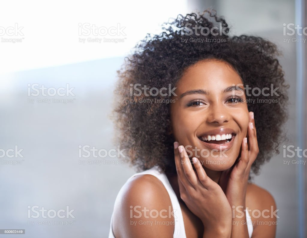 Smooth skin puts a smile on her face stock photo