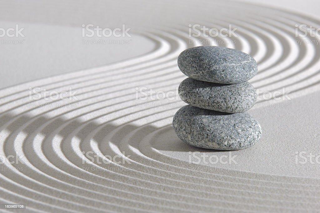 Smooth stones stacked in Zen raked garden stock photo