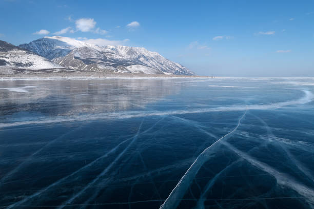 Smooth surface of frozen ice field of lake Baikal in winter stock photo