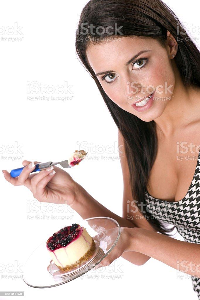 Smooth Vibrant Brunette Woman Treats Herself to Cheescake Dessert stock photo