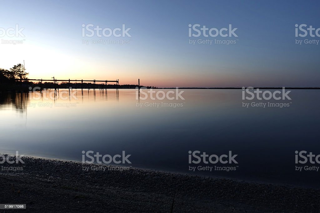 Smooth water at dusk stock photo