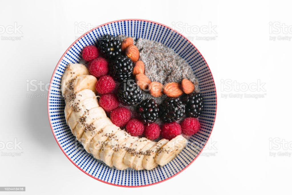 Smoothie bowl with berries, banana, almonds and chia seeds stock photo