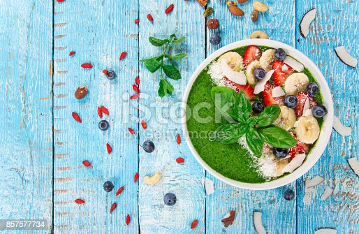 857575080 istock photo Smoothie bowl with fresh berries, nuts, seeds, fruit and vegetables 857577734