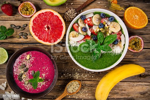 857575080 istock photo Smoothie bowl with fresh berries, nuts, seeds, fruit and vegetables 857577850