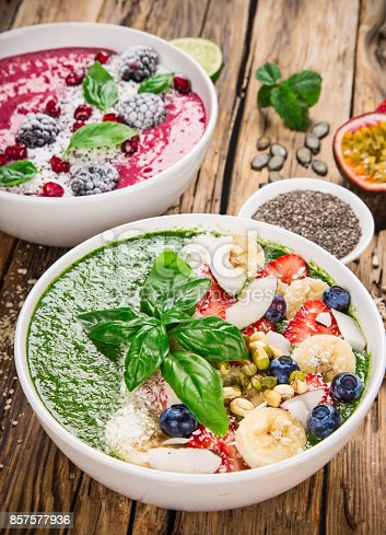 857575080 istock photo Smoothie bowl with fresh berries, nuts, seeds, fruit and vegetables 857577936