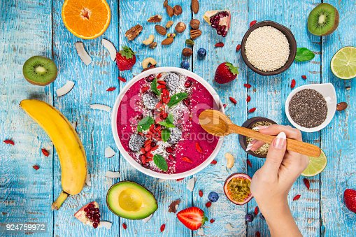857575080 istock photo Smoothie bowl with fresh berries, nuts, seeds, fruit and vegetables 924759972