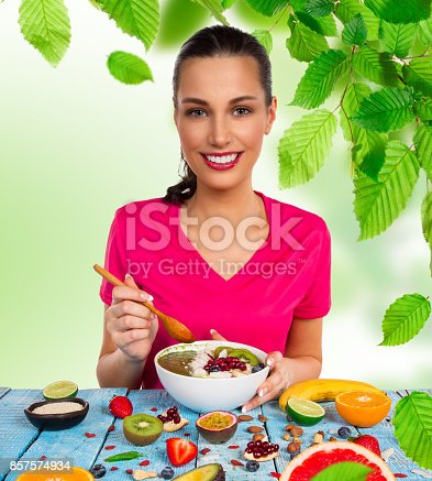 857575080 istock photo Smoothie bowl with happy young woman 857574934
