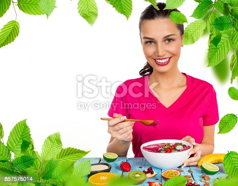 857575080 istock photo Smoothie bowl with happy young woman 857575014