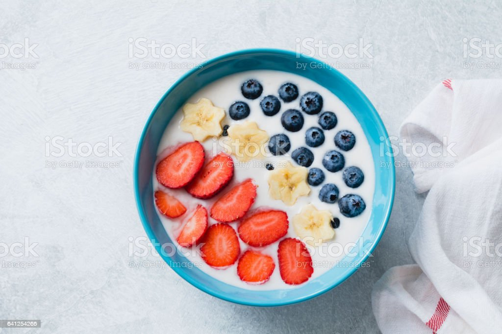 Smoothie bowl with strawberries, blueberries and bananas stock photo