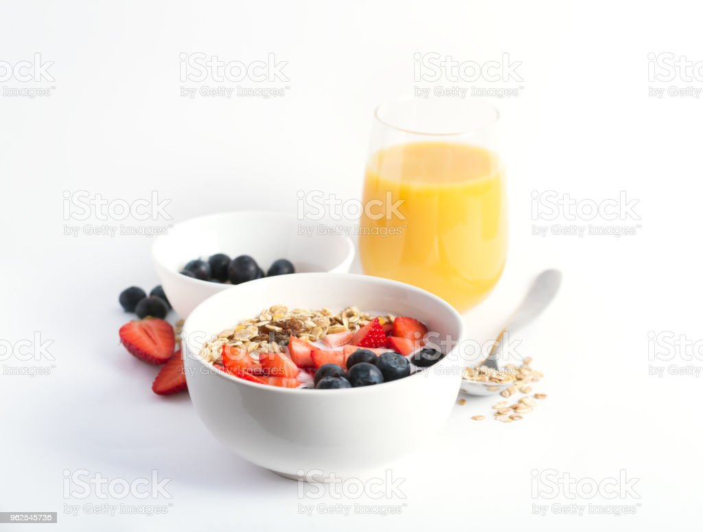 Smoothie bowl with yogurt, fresh berries and cereal. Isolated on white background - Royalty-free Antioxidant Stock Photo