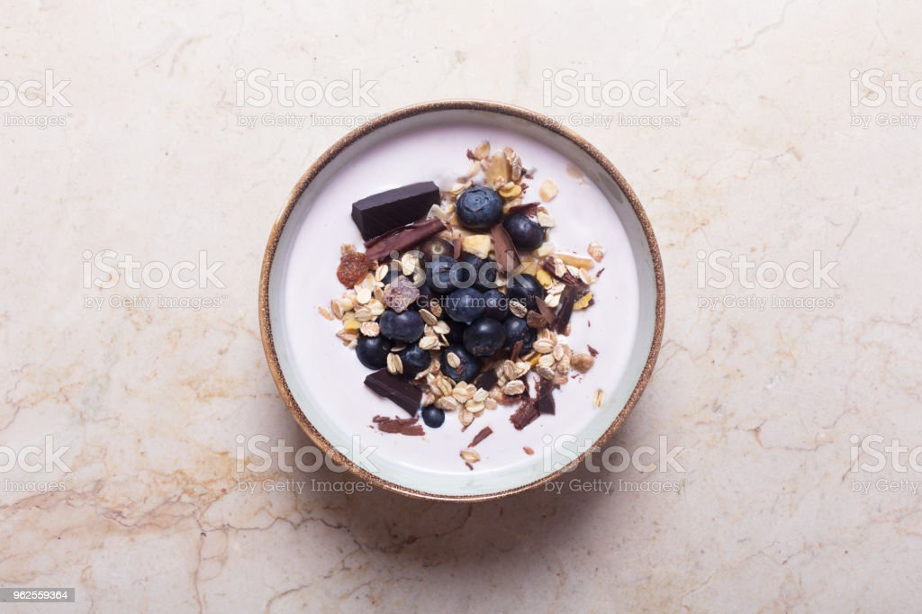 Smoothie bowl with yogurt, fresh berries and cereal stock photo