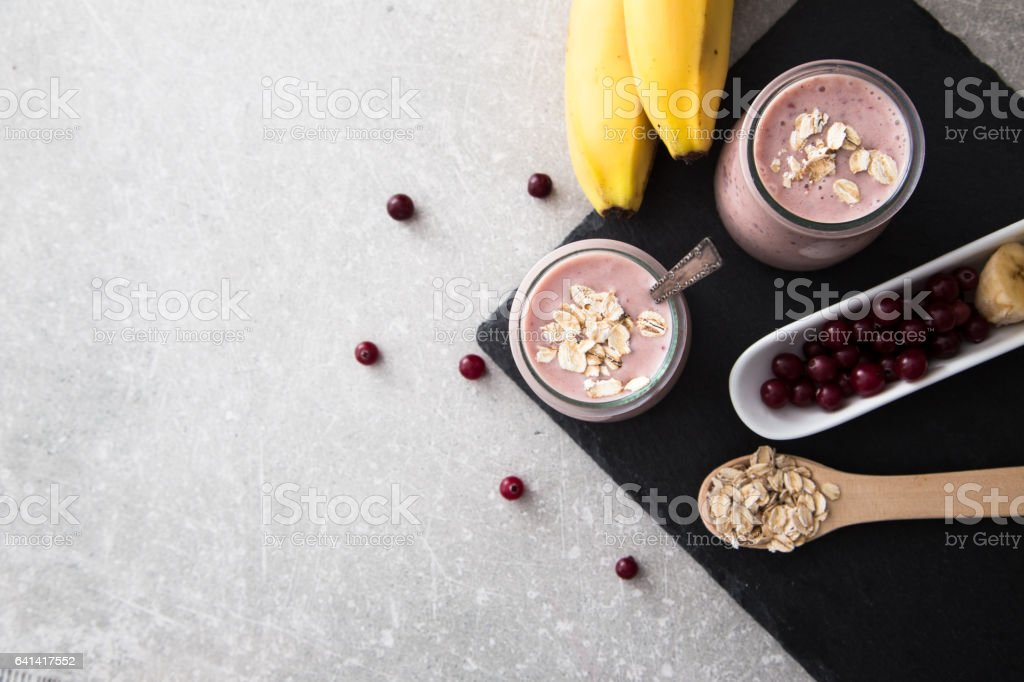 Smoothie of banana and cranberries with yogurt and oats stock photo