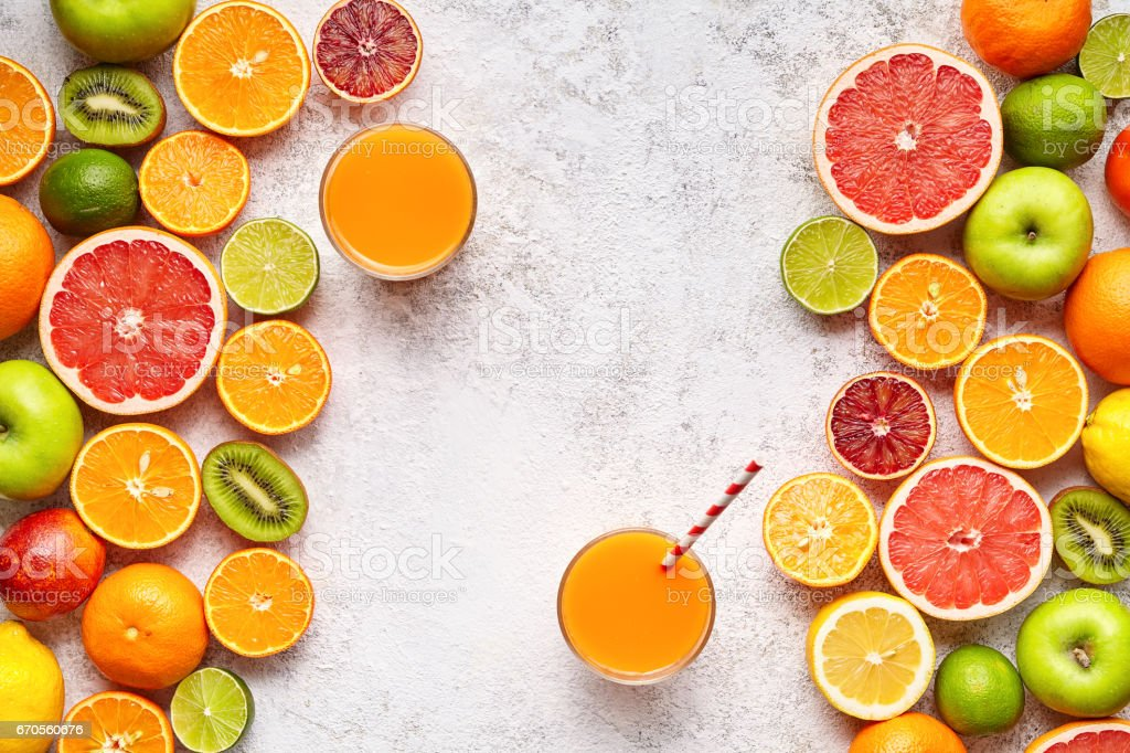 Smoothie or fresh juice vitamin in citrus fruits background flat lay, helthy natural beverage stock photo
