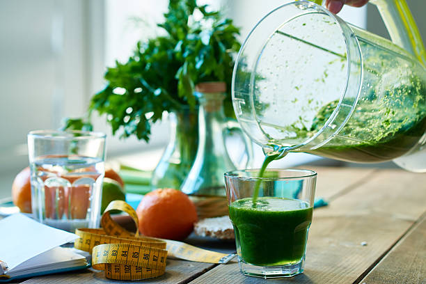 Smoothie Close-up of drinking glass and jug with smoothie detox stock pictures, royalty-free photos & images