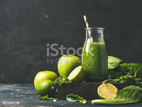 istock Smoothie with apple, romaine lettuce, lime and mint, copy space 627432128