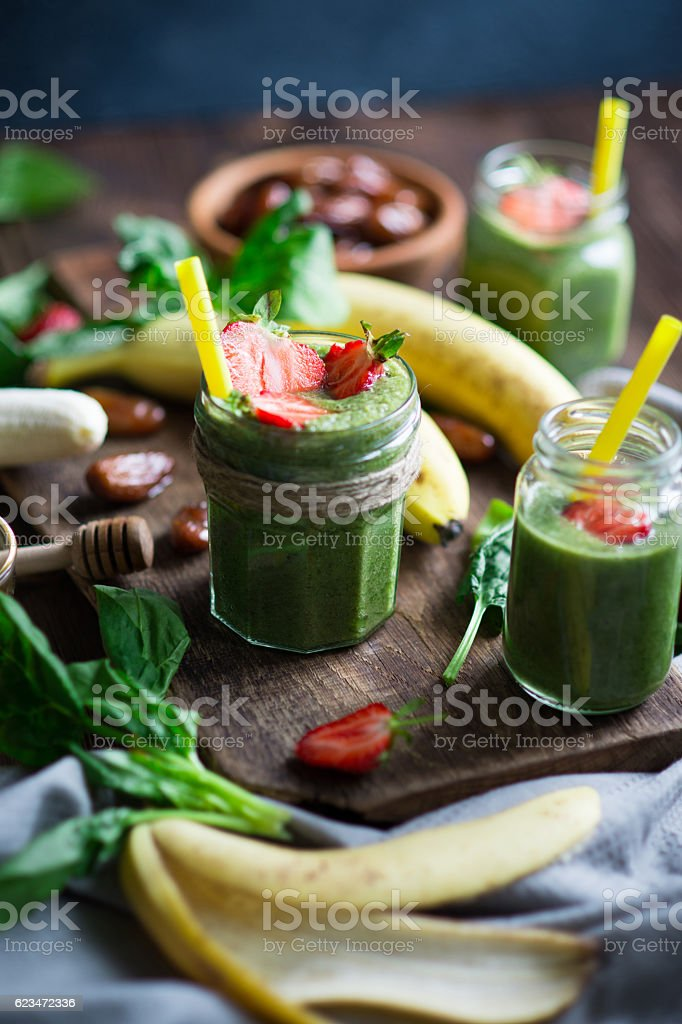 Smoothie with banana, spinach and dates stock photo