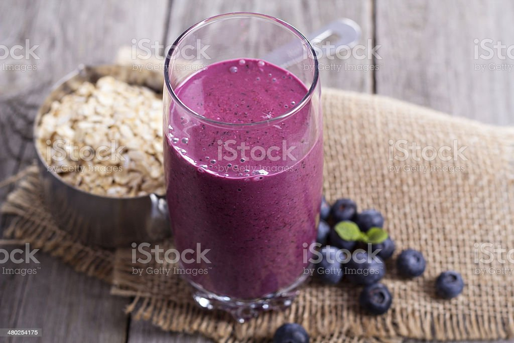 Smoothie with blueberries and oatmeal stock photo