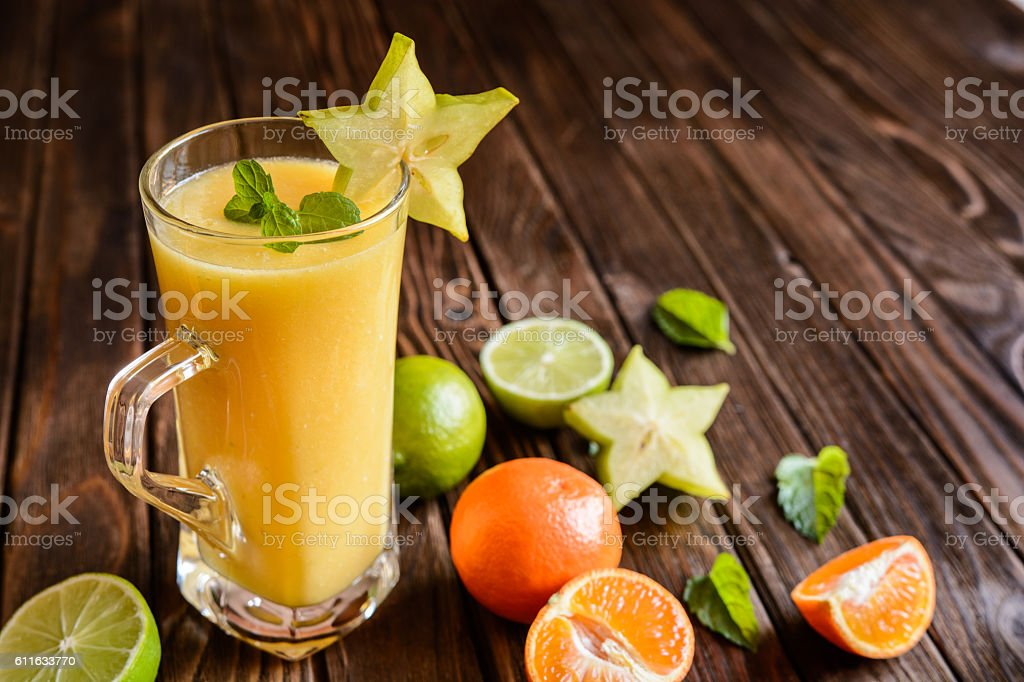 Smoothie with mandarins, carambola and lime stock photo