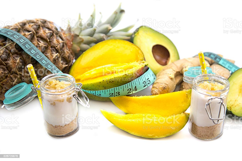 smoothie with tropical fruits, pineapple, mango and avocado stock photo