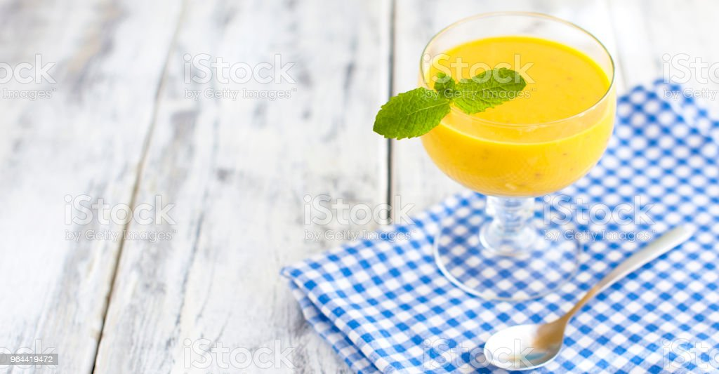 smoothies with banana, blue napkin and wooden background. Place for text - Royalty-free Abstract Stock Photo