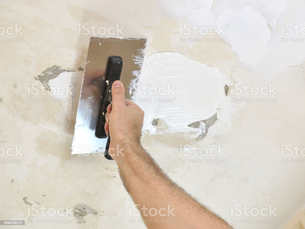 Smoothing a Ceiling stock photo
