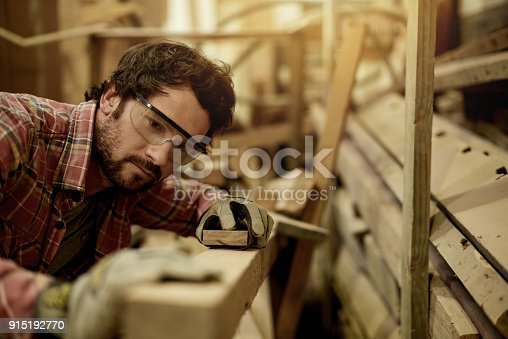 915192732 istock photo Smoothing his wood 915192770
