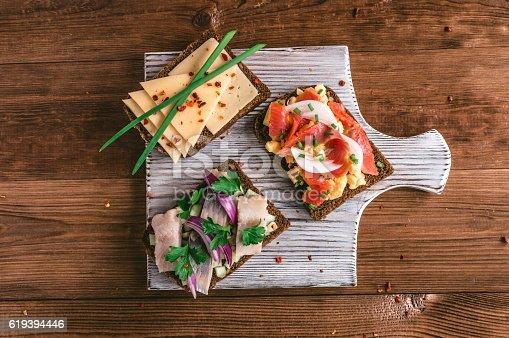 istock Smorrebrod - danish open sandwich with fish, herring, cheese 619394446