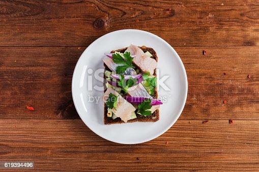 istock Smorrebrod - danish open sandwich with fish, herring, cheese 619394496