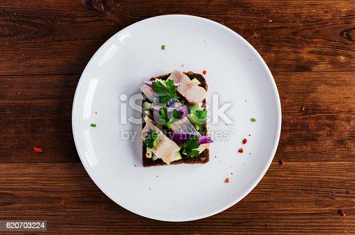 istock Smorrebrod - danish open sandwich with fish, herring, cheese 620703224