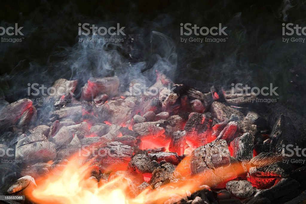 Smoulder charcoal, flames royalty-free stock photo