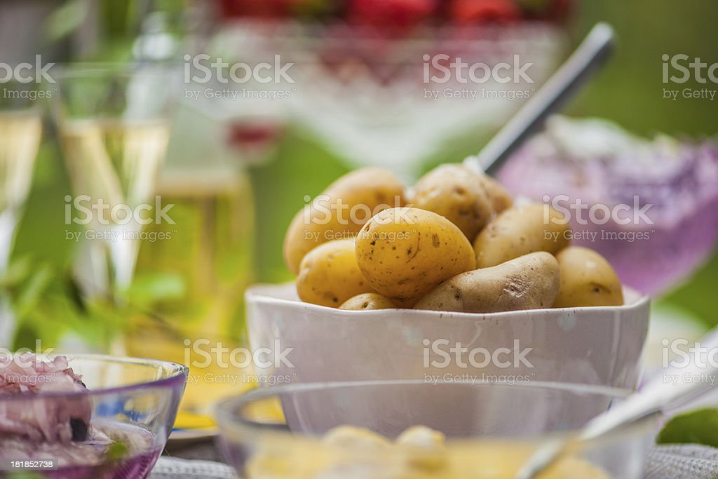 Smörgåsbord with pickled herring and potatoes stock photo